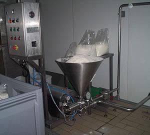 Mezclador en línea sólido-líquido con adición directa del sólido al cabezal mezclador